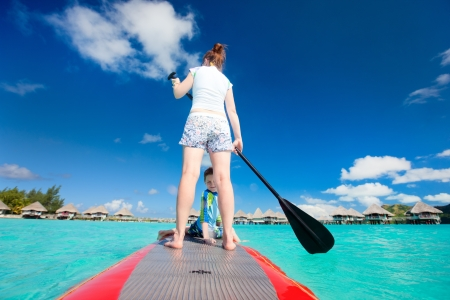 bora bora: Mother and son paddling on stand up paddle board