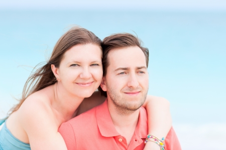 Portrait of beautiful couple outdoors on summer day photo