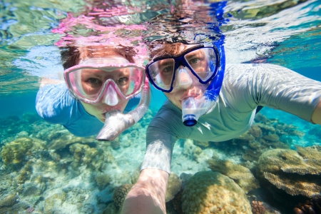 Underwater photo of a couple snorkeling in ocean photo