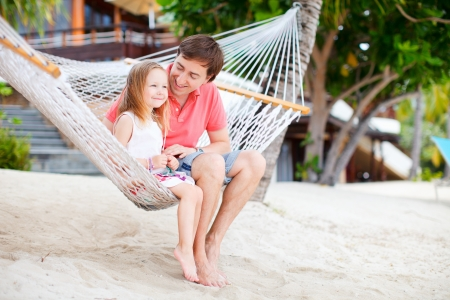 Father and daughter relaxing in hammock photo