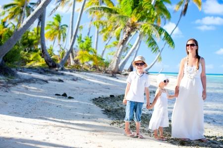deserted: Beautiful family of mother and two kids on a deserted island