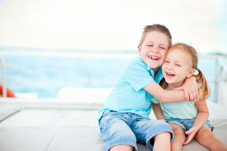 summer girl: Happy brother and sister embracing each other