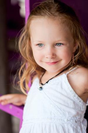 sundress: Charming little girl in white sundress and black pearl necklace