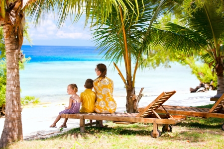 Mother and her two kids on vacation enjoying ocean view Stock Photo - 15810765