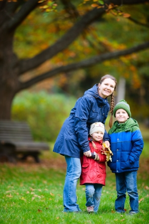 Mother and kids outdoors at beautiful autumn park Stock Photo - 15892578