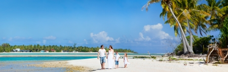 Panoramic photo of beautiful Caucasian family on beach vacation