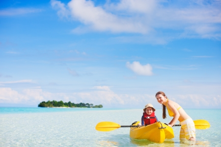 Young beautiful mother and her son preparing for kayaking Stock fotó