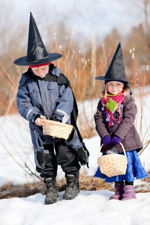 finnish: Kids outdoors dressed for Easter traditional celebration in Finland Stock Photo