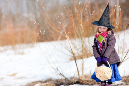 finnish: Adorable little girl outdoors dressed for Easter traditional celebration in Finland Stock Photo