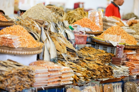 sandakan: Different kinds of dried fish and shrimps at market in Malaysia
