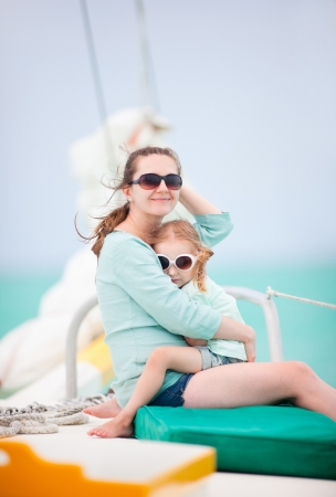 Mother and daughter relaxing on a luxury yacht photo
