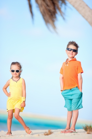 Brother and sister at beautiful white sand beach Stock Photo