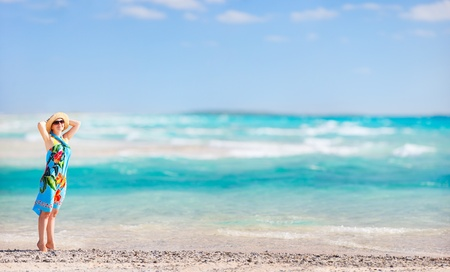 Panoramic photo of beautiful woman on a tropical vacation photo
