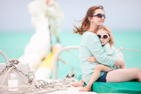 yacht people: Mother and daughter sailing on a luxury yacht