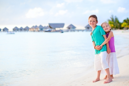 Two kids at tropical resort beach on Bora Bora island photo