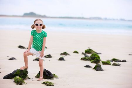 Portrait of cute little girl at tropical beach Stock Photo - 17603586