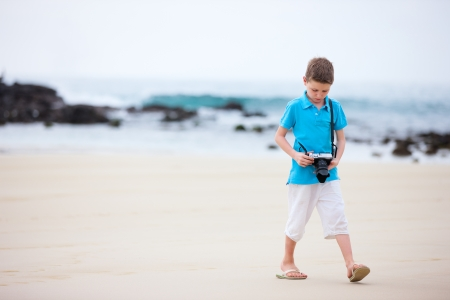 Little boy walking at tropical beach Stock Photo - 17603592