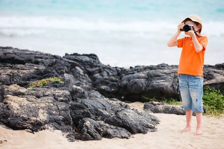 Little boy photographing at beach Stock Photo - 17603597