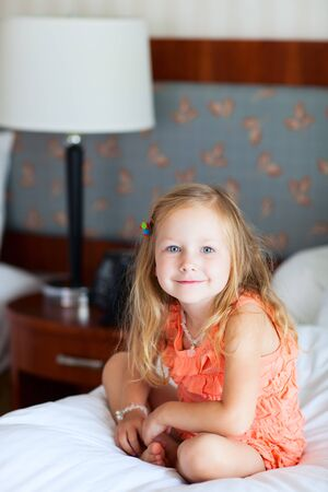 Portrait of adorable little girl at hotel room Stock Photo - 17603594
