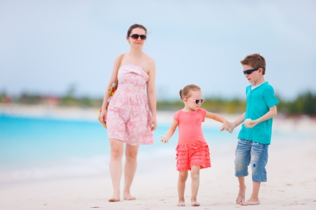 Mother and two kids on a tropical beach vacation photo