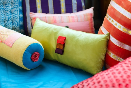 Interior decoration with colorful fabric pillows photo