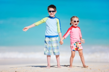 Brother and sister enjoying time at tropical beach Stock Photo - 18351542