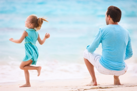 Father and daughter having fun at beach Stock Photo - 18351544