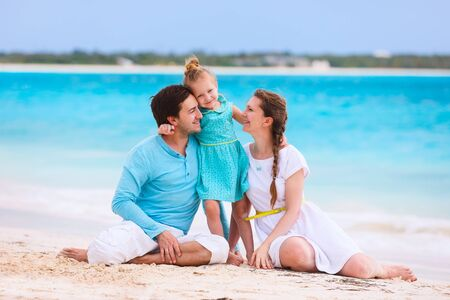 Portrait of a beautiful Caucasian family on tropical vacation photo