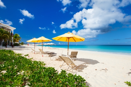 Chairs and umbrellas on a beautiful tropical beach at Anguilla, Caribbean photo