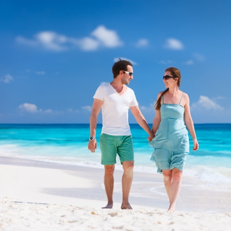 Couple on a tropical beach at Caribbean photo