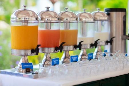 buffet table: Row of fresh juice at buffet restaurant Stock Photo