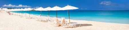 anguilla: Chairs and umbrellas on a beautiful Caribbean beach Stock Photo