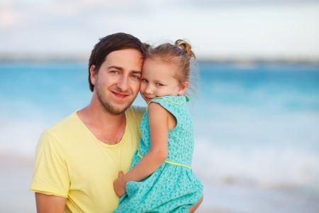 Happy father and his sweet little daughter at beach Stock Photo - 18499540