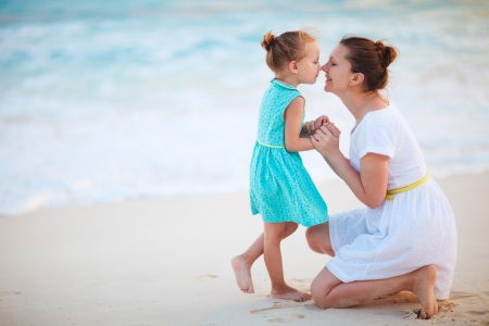 mum and daughter: Mother and daughter enjoying time at tropical beach Stock Photo