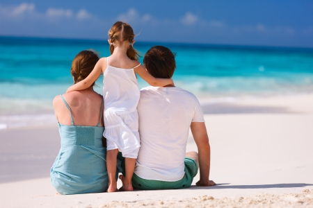 Back view of a family on a tropical beach photo