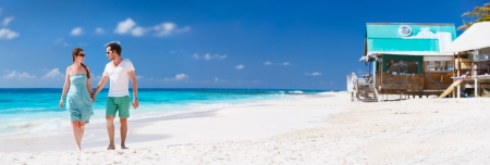 anguilla: Panorama of a couple on a tropical beach at Caribbean Stock Photo