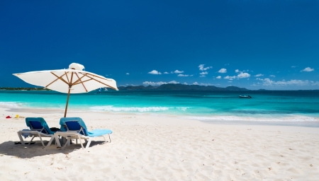 Chairs and umbrellas on a beautiful Caribbean beach photo