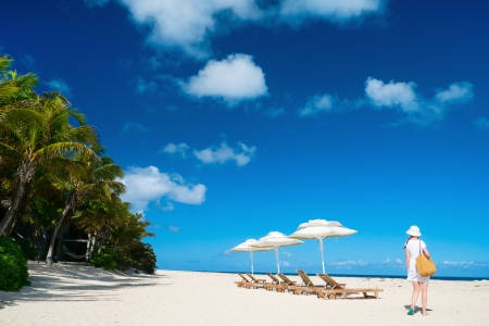 anguilla: Beautiful woman on a tropical beach at Caribbean