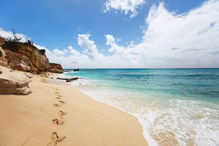 sint: Sandstone cliffs at beautiful Cupecoy Beach on Sint Maarten Stock Photo