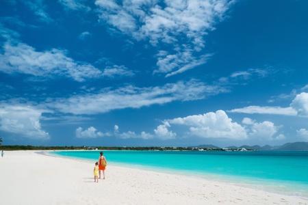anguilla: Family walking along a beach at Caribbean