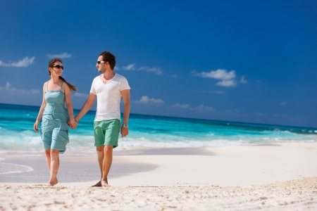 anguilla: Couple on a tropical beach at Caribbean Stock Photo