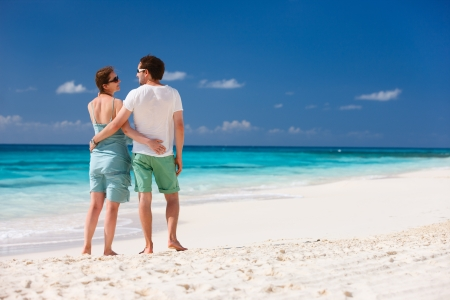 anguilla: Back view of a couple on a tropical beach at Caribbean