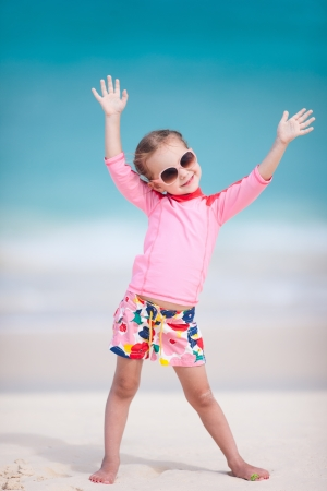 beach wear: Portrait of cute little girl at tropical beach