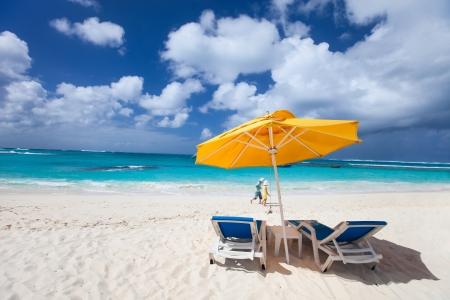 panoramic beach: Chairs and umbrellas on a beautiful Caribbean beach Stock Photo