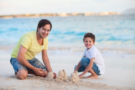 Father and his son at tropical beach photo