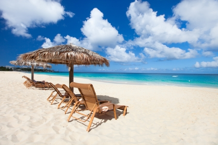 Chairs and umbrellas on a beautiful tropical beach at Anguilla, Caribbean