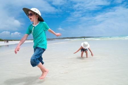 kids having fun: Happy small kids having fun at tropical beach