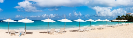 Row of chairs and umbrellas on a beautiful tropical beach at Anguilla, Caribbean photo
