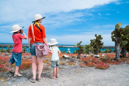 ecotourism: Mother and two kids hiking at scenic terrain on Galapagos