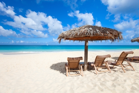 Chairs and umbrella on a beautiful tropical beach at Anguilla, Caribbean photo